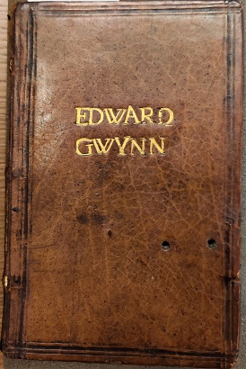 The front of Edward Gwynn's distinctive binding with his name gold stamped on brown leather