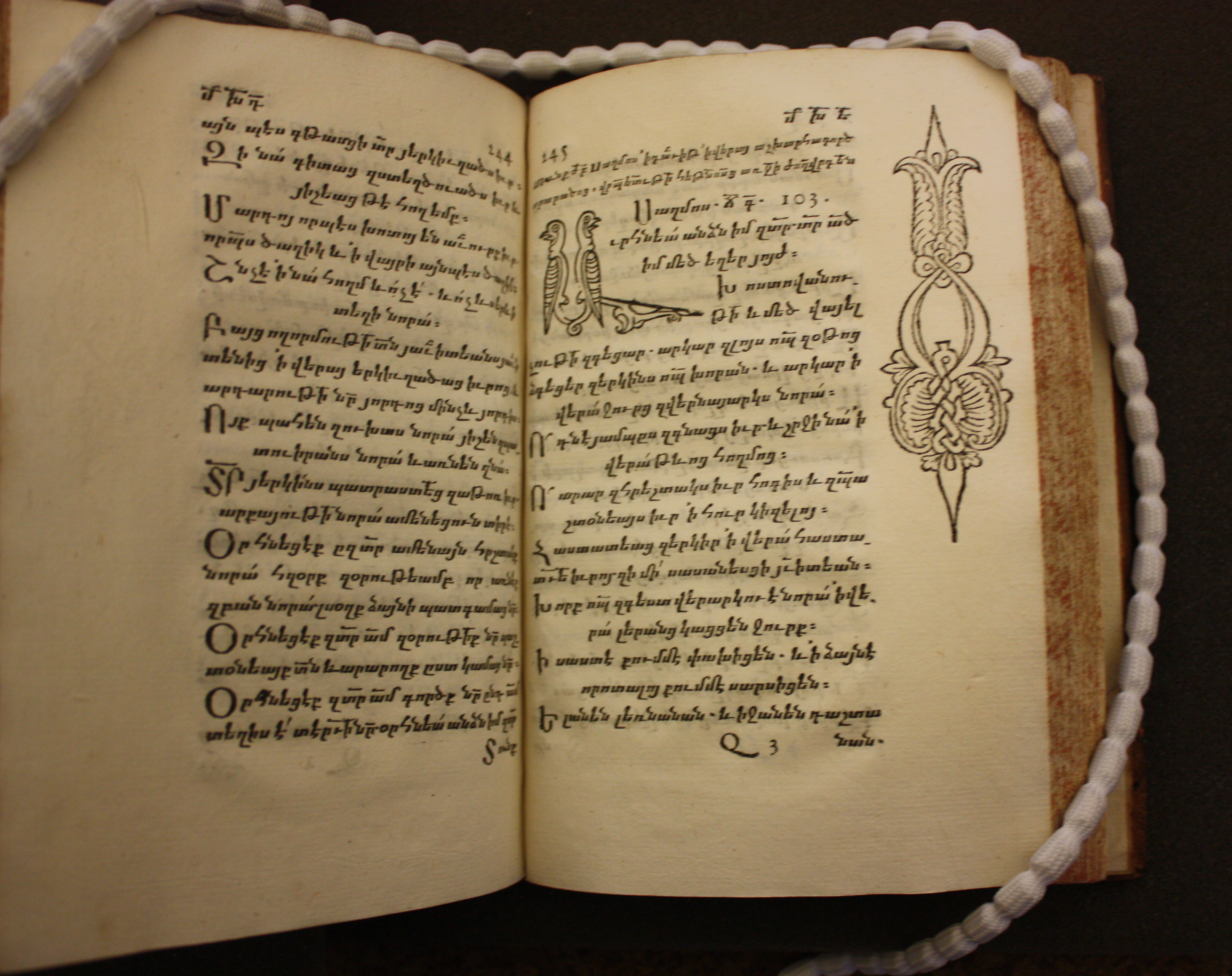 Opening of book in Armenian, showing text and zoomorphic initials